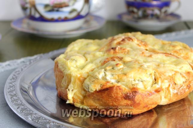 Фото Закусочный пирог из слоёного теста и сыра