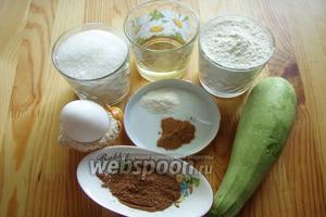 Для приготовления шоколадных маффинов с кабачком нам понадобятся: мука, сахар, тёртый свежий кабачок, разрыхлитель, какао, корица, яйцо куриное, масло растительное рафинированное.