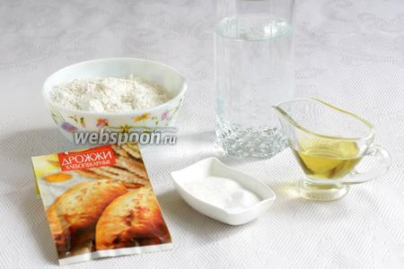Для теста нам понадобятся — тёплая вода, мука, сухие дрожжи, масло оливковое, соль и сахар.