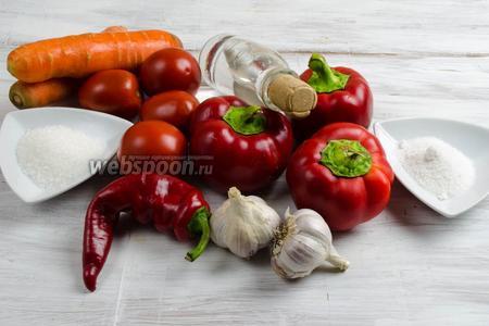 Чтобы приготовить аджику, нужно взять острый перец, чеснок, соль, сахар, морковь, сладкий перец, уксус.