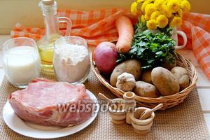 Для приготовления блюда нам понадобится мясо (свинина), картофель, лук, морковь, специи. Для приготовления нудлей нужен кефир, мука, зелень, чеснок, соль, масло растительное и 1/4 ч. л. соды.