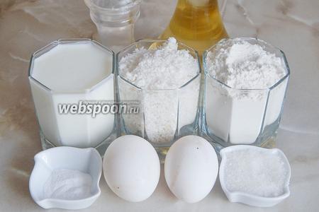 Готовить кокосовые оладьи мы будем из кефира (комнатной температуры), яиц, муки пшеничной, кокосовой стружки, сахара, разрыхлителя, соли и подсолнечного масла без запаха (для жарки).