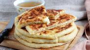 Фото рецепта Хачапури с сыром и брынзой
