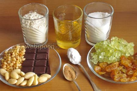 Для приготовления коврижки нам понадобится мука, сахар, горький шоколад, кедровые орехи, миндаль, изюм, лимонные цукаты, сода, мёд и специи: молотая корица, белый и чёрный молотый перец, гвоздика, молотый мускатный орех и кардамон. У меня получилась 1 ч.л. специй.