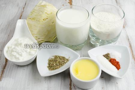 Чтобы приготовить блинчики, необходимо взять: капусту белокочанную, молоко, яйца, муку, сыр (творог) зернистый, сахар, соль, паприку, перец чёрный молотый, белокочанную капусту, топлёное масло для жарки.