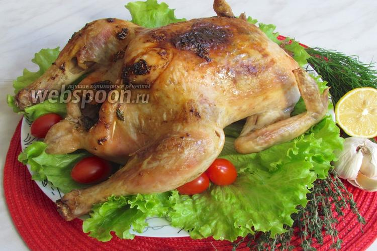Фото Курица запечённая с лимоном, чесноком и травами