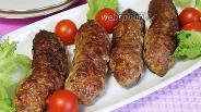 Фото рецепта Мясные колбаски с чесноком