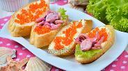 Фото рецепта Бутерброды с осьминогами и красной икрой
