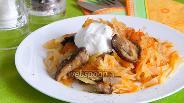 Фото рецепта Тушёная капуста с грибами в мультиварке