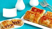 Фото рецепта Блинчики с начинкой из куриных желудочков и риса