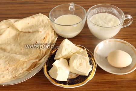 Для пирога из лаваша нужны свежий тонкий армянский лаваш, сыр, яйцо, молоко, йогурт и соль.