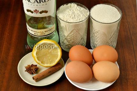 Для приготовления ромовых баб возьмём муку, яйца, сахар, разрыхлитель, ром, воду, палочку корицы, звёздочку аниса, лимон для цедры.