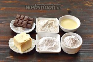 Для приготовления печенья нам понадобится картофельный крахмал, пшеничная мука, сливочное масло, сахарная пудра, молоко, разрыхлитель, чёрный шоколад.