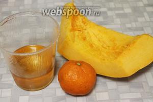 Для запекания взять тыкву, мёд и мандарин.