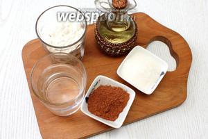 Для приготовления постного шоколадного кекса возьмите муку пшеничную, какао порошок, масло растительное, сахар, разрыхлитель, сахарную пудру и воду.