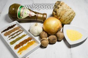 Тем временем подготовим смесь пряностей и остальные продукты, необходимые для приготовления супа харчо. Взять соус ткемали, корень сельдерея, лук (2 шт.), чеснок, муку кукурузную, орехи грецкие, зелень кинзы, соль и смесь пряностей: хмели-сунели, кориандр, душистый и чёрный перец, гвоздику (измельчить в ступке), корицу, куркуму (можно шафран).