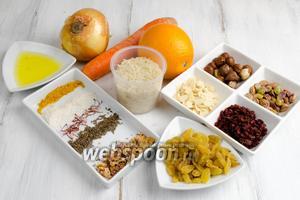 Чтобы приготовить праздничный рис, нужно взять рис басмати, воду, лук, морковь, кожуру апельсина, изюм, сахар, соль, барбарис, лесные орехи, фисташки, лепестки миндаля, кумин, шафран, куркуму, лепестки чайной розы, топлёное масло.