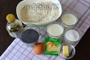 Ингредиенты для приготовления пирога: мак, сахар, мука, дрожжи, молоко, кефир, растительное масло, сливочное масло и яйца.