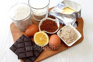 Для приготовления нам понадобятся тёмный шоколад, сливочное масло, яйца куриные, сахар, сахарная пудра, ванилин, мука, разрыхлитель, фундук или миндаль, лимонный сок, крахмал и какао порошок.