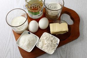 Для приготовления нам понадобятся масло сливочное, сахар, сахарная пудра, яйца куриные, ванилин, мука пшеничная, молоко, джем абрикосовый, лимонный сок, разрыхлитель и кокосовая стружка.