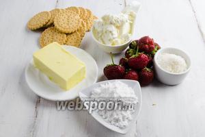 Чтобы приготовить десерт, нужно взять клубнику, печенье, масло сливочное, творог жирный мягкий, сахарную пудру, кокосовую стружку.