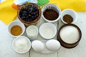 Возьмите следующие ингредиенты: фасоль чёрную, какао-порошок, кофе растворимый, куриные яйца, молоко, ванильный экстракт, сахар, кокосовую стружку, соль, шоколад.