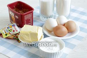 Для приготовления кекса «Леопард» возьмём все продукты по списку: яйца среднего размера, мягкое масло, сахар, муку, крахмал кукурузный, щепотку соли, ванилин и разрыхлитель, шоколад для украшения (необязательно). Количество какао зависит от его качества, чуть больше или чуть меньше, до интенсивного цвета. Все продукты должны быть комнатной температуры.