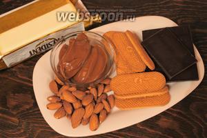 Для приготовления потребуется сгущёнка, масло, печенье, шоколад, миндаль, орехи.