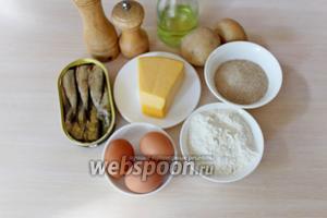 Приготовить ингредиенты: картофель, шпроты, яйца, сыр, панировочные сухари, муку, специи и масло растительное для жарки.