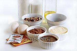 Для приготовления брауни с грецкими орехами возьмём муку, сахар, масло растительное, сливочное, орехи, шоколадные капли, соль, ванилин, яйца, кофе, какао, ванилин и разрыхлитель.