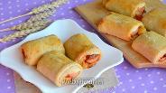 Фото рецепта Рулеты с сосисками и сыром