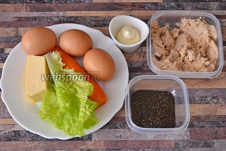 Для приготовления яиц фаршированных вам понадобится икра трески, яйца куриные, морковь, листья салата, сыр, перец чёрный молотый и майонез.