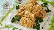 Фото рецепта Блинные мешочки с курицей и рисом