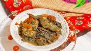 Фото рецепта Хек тушёный на овощной подушке