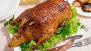 Фото рецепта Утка с яблоками, клюквой и квашеной капустой