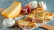 Фото рецепта Крепы с шампиньонами и ветчиной