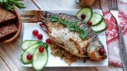 Фото рецепта Запечённые караси, фаршированные квашеной капустой