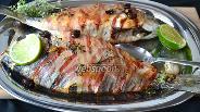 Фото рецепта Дорада фаршированная в беконе