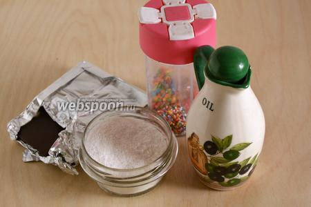 Для обжаривания и декорирования пончиков понадобятся следующие ингредиенты: горький шоколад (75-85% какао), сахарная пудра, растительное масло и кондитерская посыпка