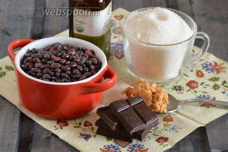 Подготовьте необходимые ингредиенты для приготовления конфет: сухую красную фасоль, арахисовую пасту, сахар, ванильный экстракт и шоколад. Сахар кладите по вкусу, так как горький шоколад бывает иногда несладким, а бывает с добавлением сахара в достаточном количестве.