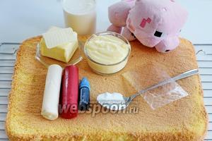 Подготовим ингредиенты. Бисквит на 6 яиц (шведский) по вашему выбору, моделирующий марципан розовый 600 г, белый 30 г для глазок, синий или чёрный 30 г, тоже для глазок, красный 40 г для квадратиков, крем или наполнитель по вашему желанию. Главное, чтоб было 500 г (Патисьер из Шведского торта), сливки для сливочного крема и сахарную пудру, масло сливочное для добавления в Патисьер или для обмазывания поверхности торта под марципан или абрикосовый конфитюр для абрикотирования, желатин в случае надобности, пищевый красители (розовый, красный, синий...), которые будете использовать, и саму модель свинки.
