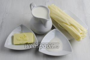 Чтобы приготовить блюдо, нужно взять сыр, сливки, ванильный сахар, масло для смазывания форм.
