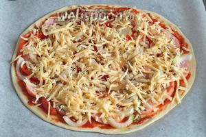 Затем натереть твёрдый сыр и покрыть заготовку. Разогреть духовку. Любая пицца выпекается 10 минут при 220°С. Приятного аппетита!