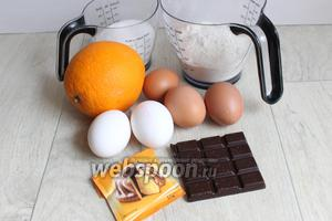Итак берем для бисквита апельсин, шоколад, яйца, сахар, муку, разрыхлитель и какао.