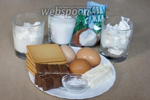 Для приготовления чизкейка понадобятся следующие продукты: сливочный сыр (крем-чиз), сметана, сахар, 2 яйца и 1 желток, крахмал, печенье, сливочное масло, шоколад, кокосовая стружка.