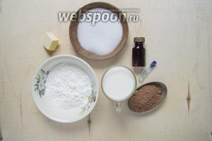 Подготовить продукты для пудинга: ванильную эссенцию, какао порошок, крахмал кукурузный, сливочное масло, молоко, сахар, ромовую эссенцию и зефир.