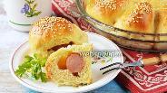 Фото рецепта Пирожки с сосиской в духовке