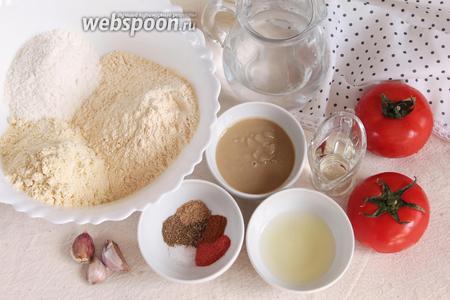 Основные ингредиенты, которые потребуется для приготовления оладий: мука гороховая, мука нутовая, мука пшеничная, вода питьевая, помидор, паста кунжутная, масло оливковое, сок лимонный, чеснок, соль, молотые зира, перец красный острый, имбирь, кориандр, паприка сладкая.