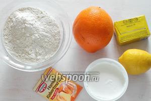 Для пирога нужно взять апельсин, лимон, сахар, масло сливочное, муку, разрыхлитель, сметану и соль.