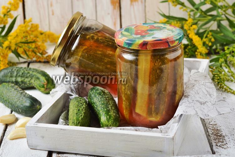Фото Огурцы с томатным соусом на зиму